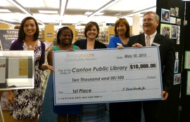 Eva Davis with some of her library trustees holding their LibraryAware award check.