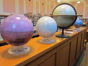 Photo of globes on a shelf in the Portland Central Library