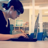 photo of librarian using a computer at a study table
