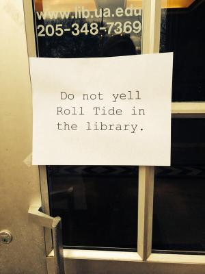 """Sign saying, """"Do not yell Roll Tide in the library."""""""