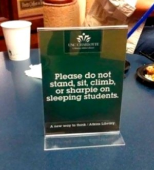 """Sign saying: """"Please do not stand, sit, climb, or sharpie on sleeping students."""""""