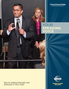 Cover of Toastmasters guide to Your Speaking Voice. includes image of young man speaking into a microphone.