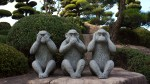 photo of three wise monkey (do no evil, see no evil, speak no evil) stone statues