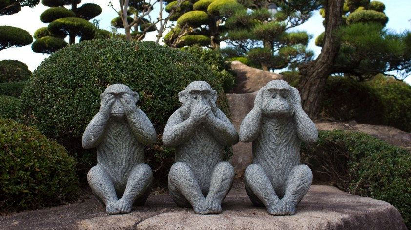 photo of three wise monkey (do no evil, see no evil, speak no evil) stone statues