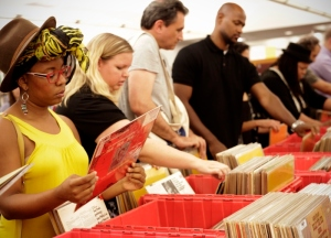 4 library users peruse the record selection